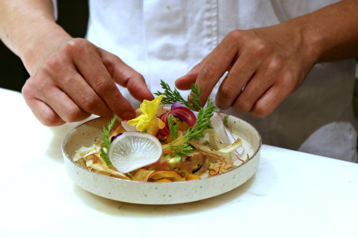 Washoku japanese cuisine wagyu and yamashina-nasu tartare salad decorated with flowers