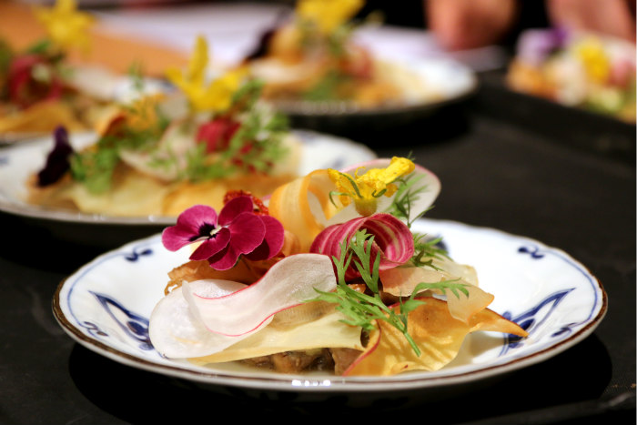 Washoku japanese cuisine wagyu and yamashina-nasu tartare salad decorated with flowers close up