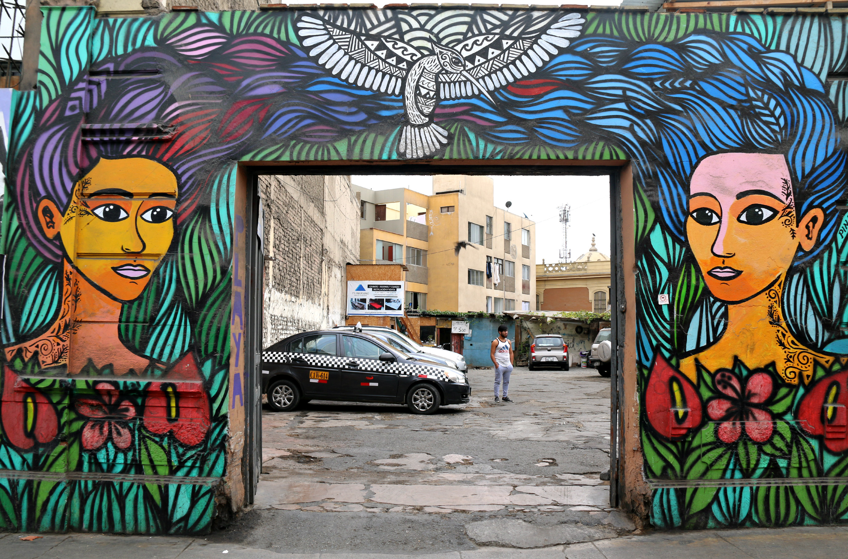 where to to find street art in Barranco, Lima on Jirón Domeyer. Mural by Carlos Pinao